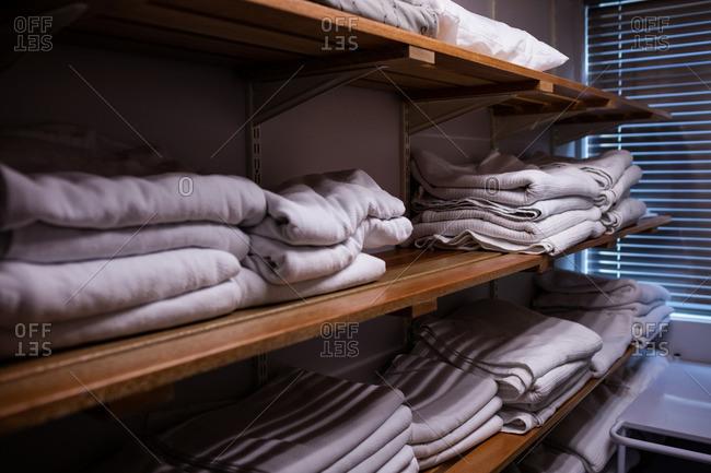 Folded blankets arranged in shelf at hospital