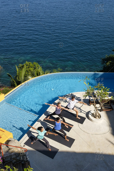 View from above at yoga group on ocean front property