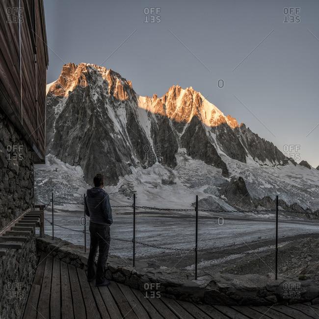 Man looking at mountaintop