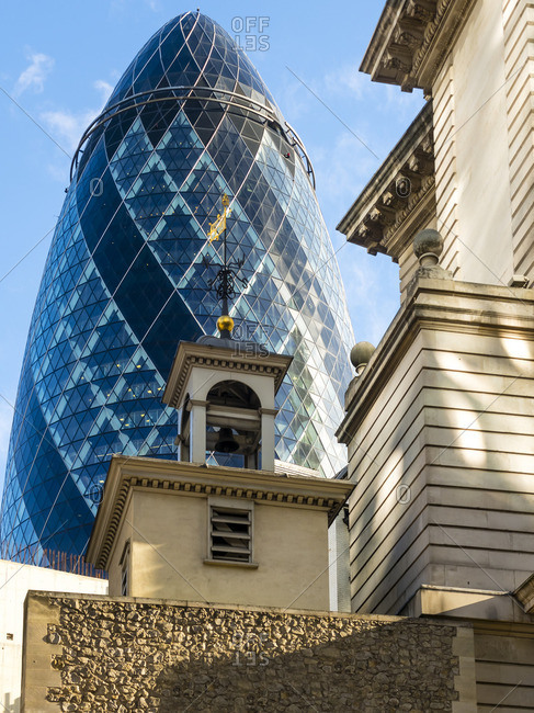 London, UK - October 18, 2016: View to Isola Bellaiew to 30 St Mary Axe and St Andrew Undershaft in the foreground