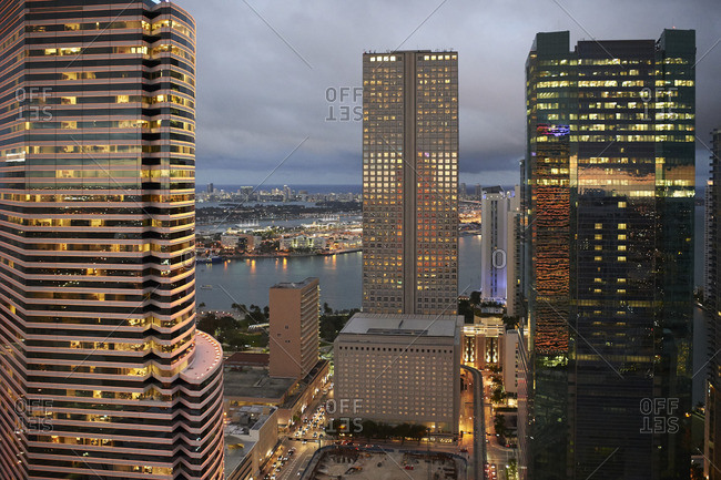 View to lighted skyscrapers in the early evening seen from above