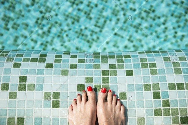Woman's feet at poolside