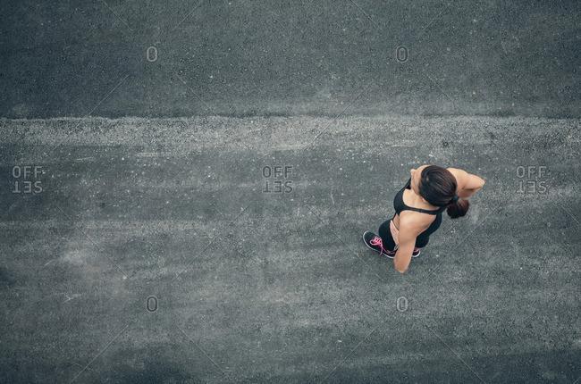 Athlete standing on asphalted ground