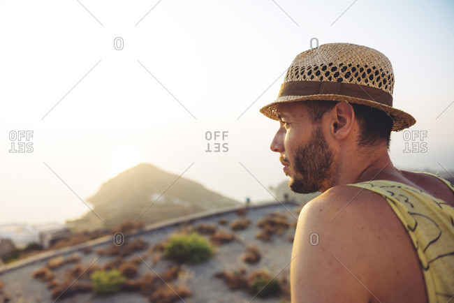Man with straw hat looking at distance
