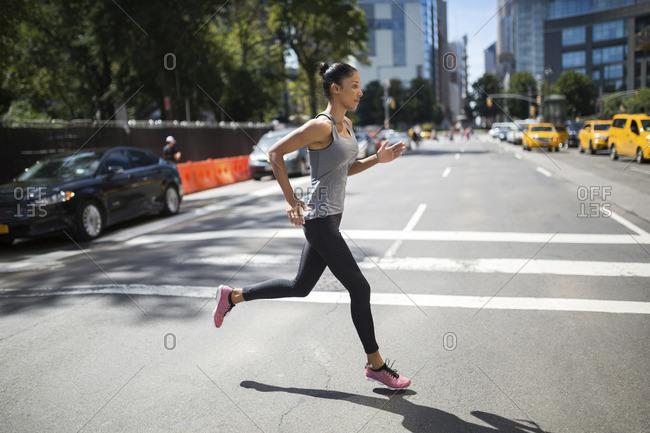 Woman running on urban street