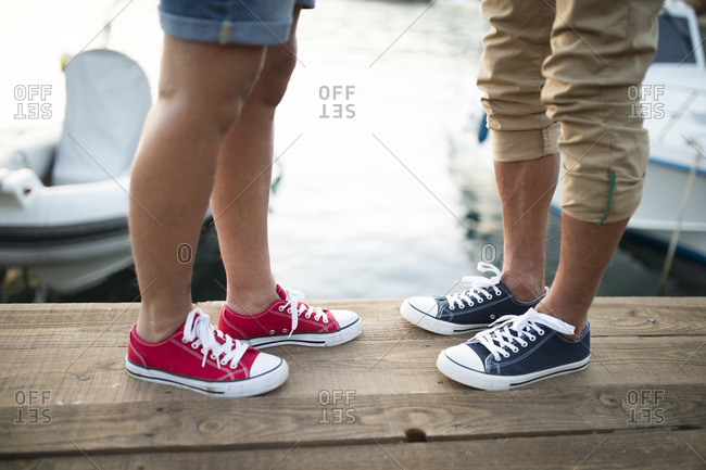 Senior couple wearing sneakers- partial view