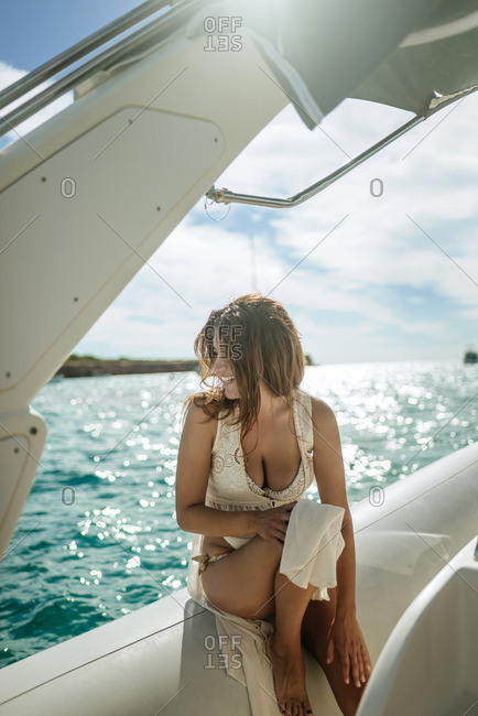 Woman sitting on a motor boat
