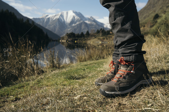 Close-up of hiker taking a rest at mountain lake