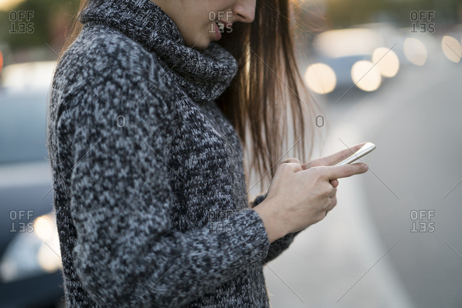 Woman using cell phone on the street