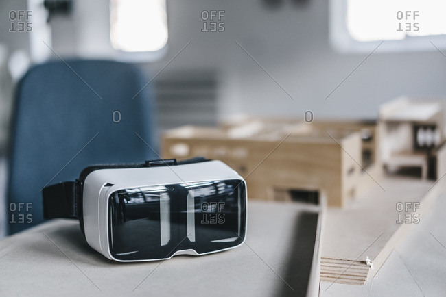 VR glasses and architectural model on desk
