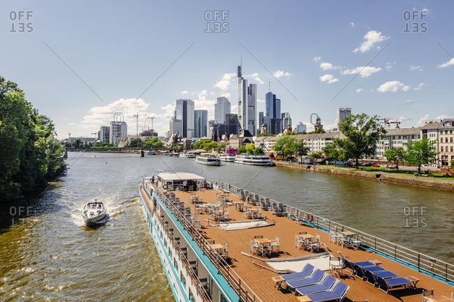 View to skyline  with tour boat on Main River in the foreground