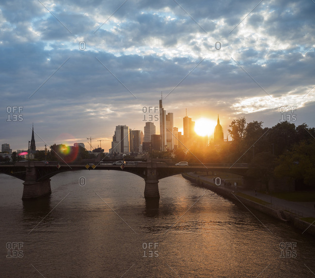 Frankfurt, Germany - August 9, 2016: View to financial district at sunset with Ignatz-Bubis-Bridge in the foreground