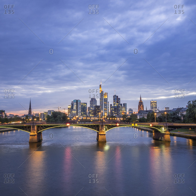 View to financial district at blue hour with Ignatz-Bubis-Bridge in the foreground