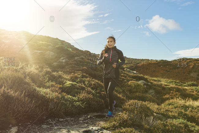 Woman running on coastal path