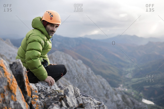 Climber resting on rock