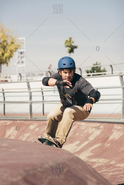 Man skateboarding in a skatepark