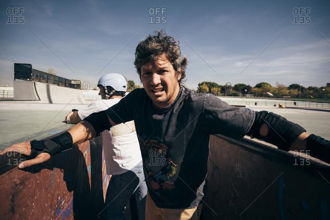 Portrait of man in a skatepark