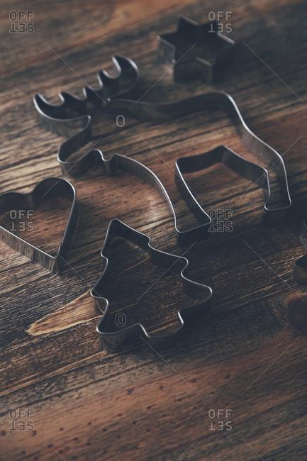 Five cookie cutters on dark wood