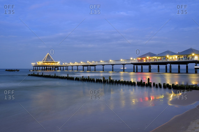 Remains of the old and new pier in the evening