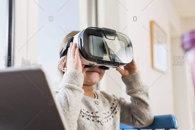 Little girl using VR glasses