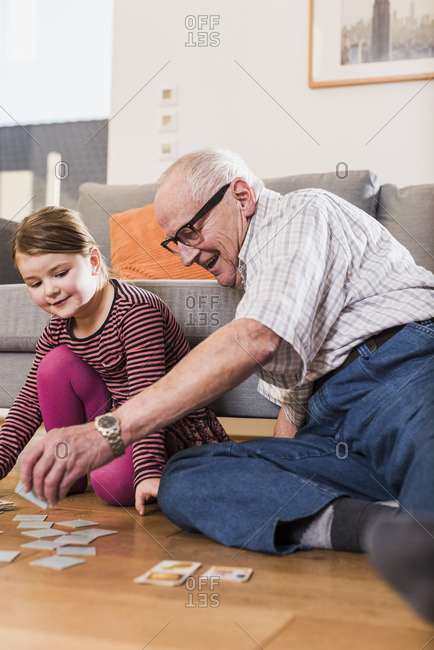 Grandfather and granddaughter playing memory