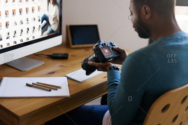 Young photographer editing images at desk