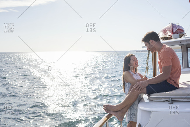 Young couple on a boat trip
