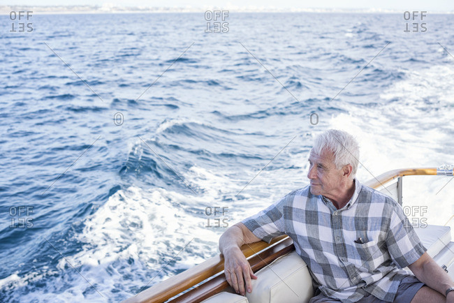 Senior man on a boat trip