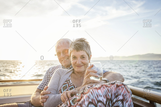 Affectionate couple on a boat trip at sunset