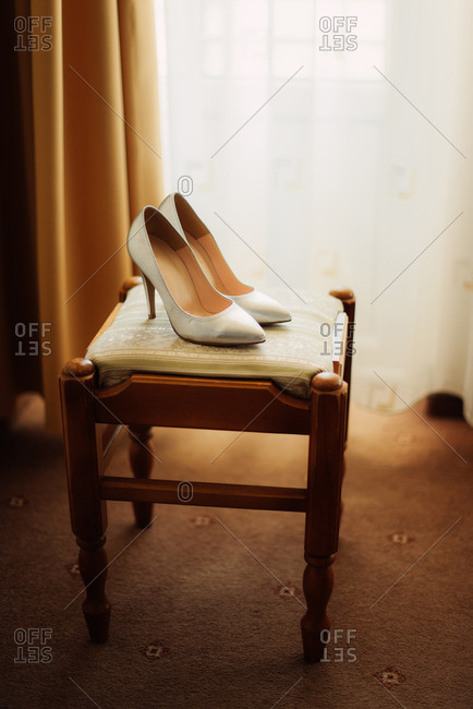 High heel shoes on a stool