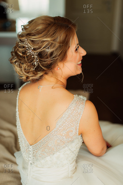 Smiling woman sitting in bridal wear