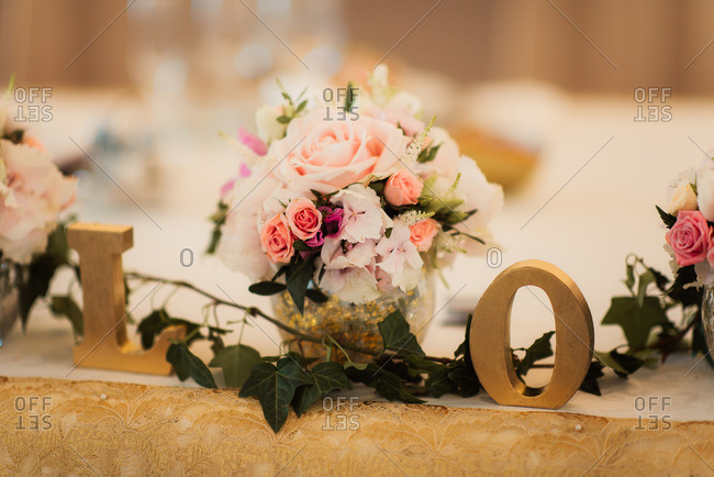 Flowers and letters decorating wedding table