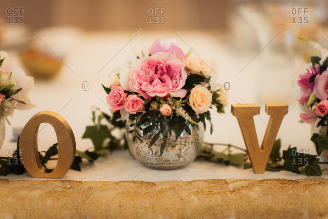 Flowers and letters on wedding table