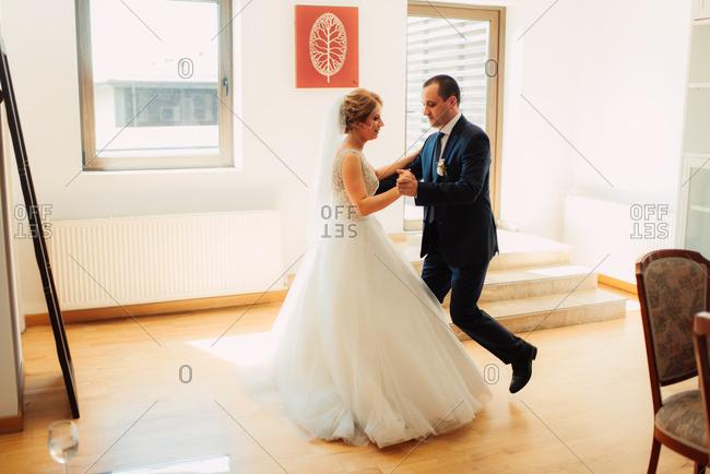 Bridal couple dancing alone