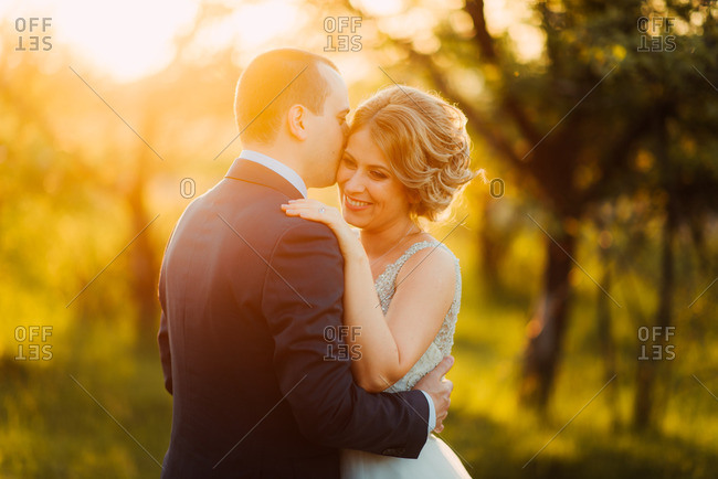 Bridal couple embracing in a sunset