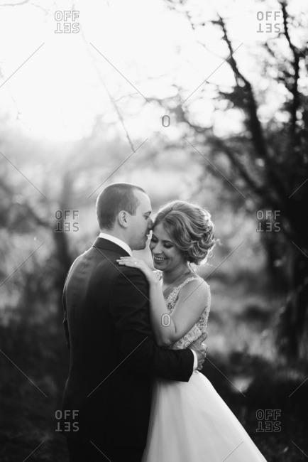 Bridal couple in intimate embrace