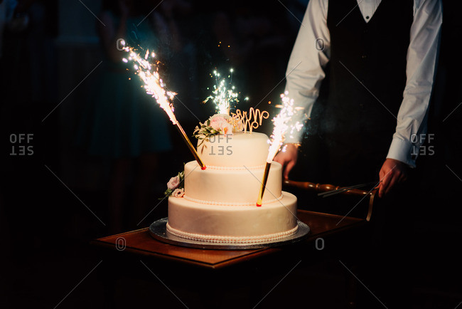 A wedding cake with sparklers