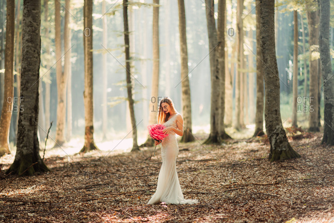 Bride in woods with paper flower