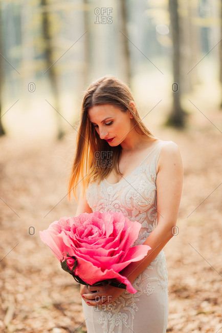 Bride in woods with artificial flower