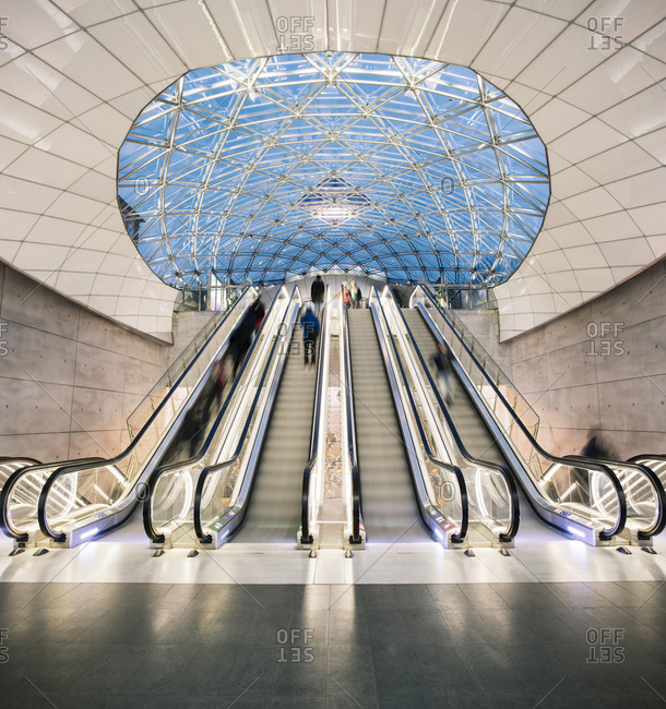 Malmo, Sweden - December 21, 2016: Blurred motion of passengers on escalators at Triangeln Station