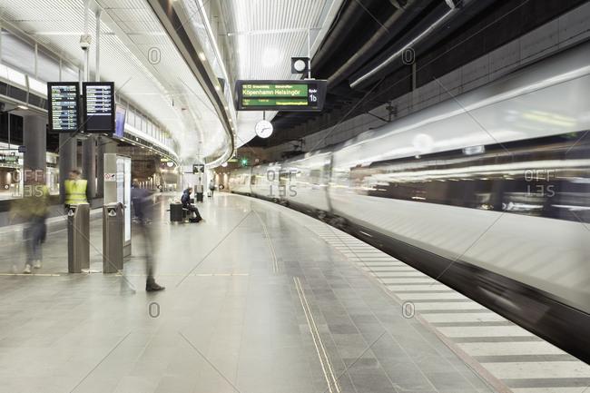 Malmo, Sweden - December 21, 2016: Moving train at illuminated subway station
