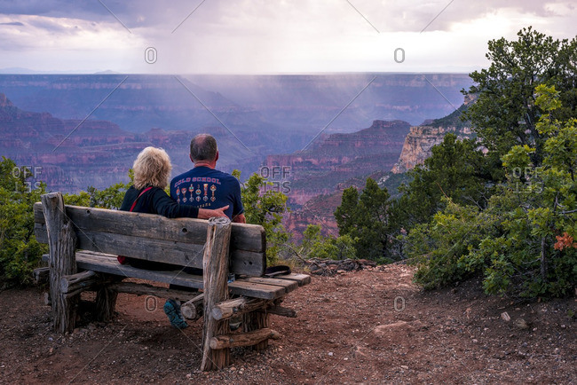 Couple looking out over the Grand Canyon