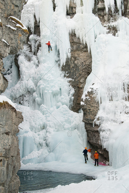 Ice climbing in wintry mountains