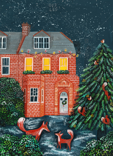 Two foxes standing next to a Christmas tree and a house
