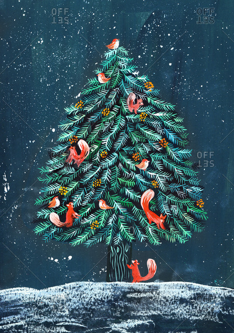 Christmas tree with squirrels and birds sitting on the branches