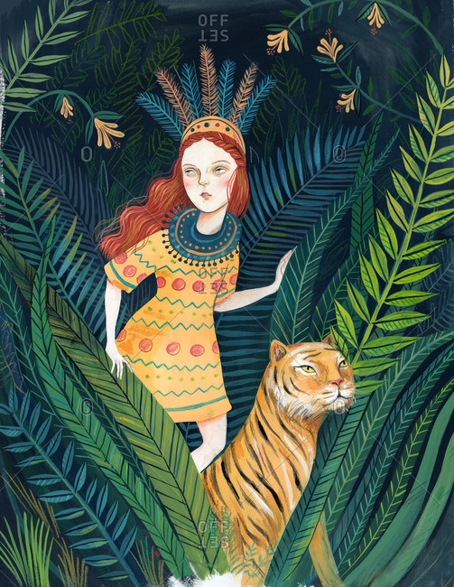 Girl walking with a tiger in the jungle