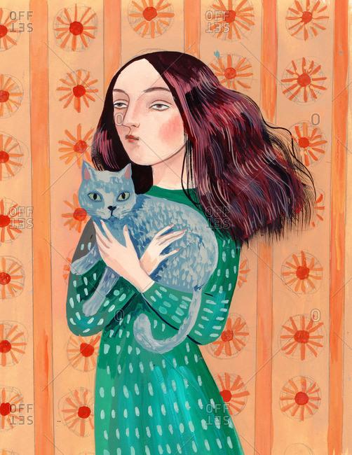 Woman hugging a grey cat