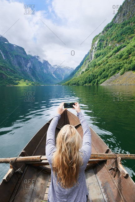 Adventure woman in row boat