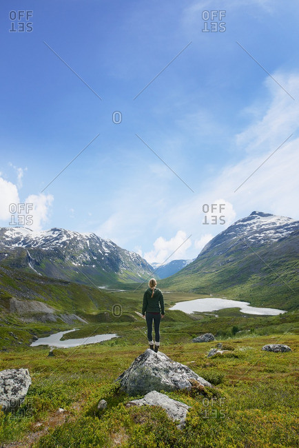 Woman enjoying view of majestic glacial valley