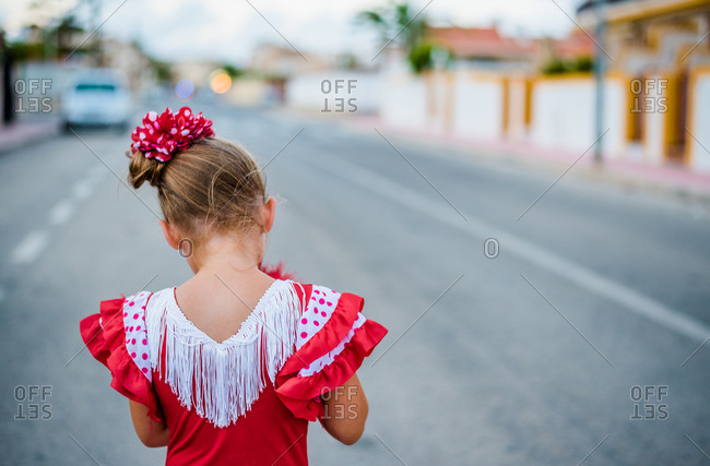Girl wearing a traditional flamenco dress